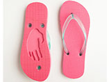 Wholesale flip flops with die cut logo on the sole